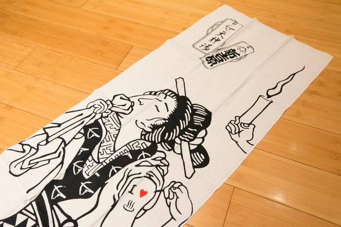 「天神湯」オリジナル手ぬぐいは1250円。