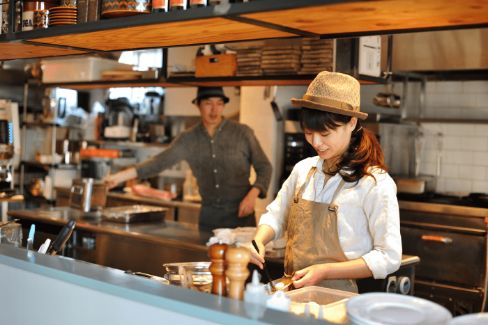 You can see the staff in the open kitchen as they quickly prepare your meal. Notice the fashionable uniforms as well.