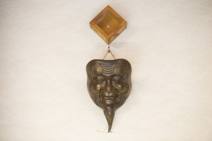 """Displayed on the wall are a masu wooden box signifying """"masu masu hanjo"""" (""""more and more prosperity"""") and an Okina mask signifying the hope for longevity."""
