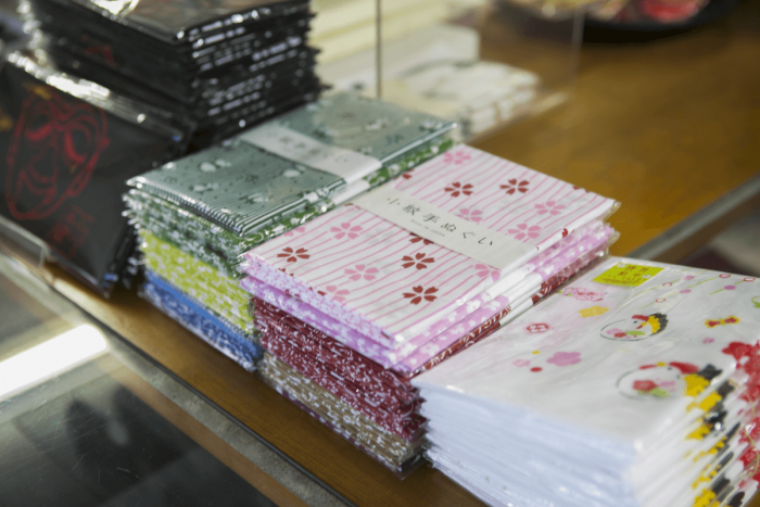 Tenugui cotton towels in Japanese designs that many customers buy as souvenirs.