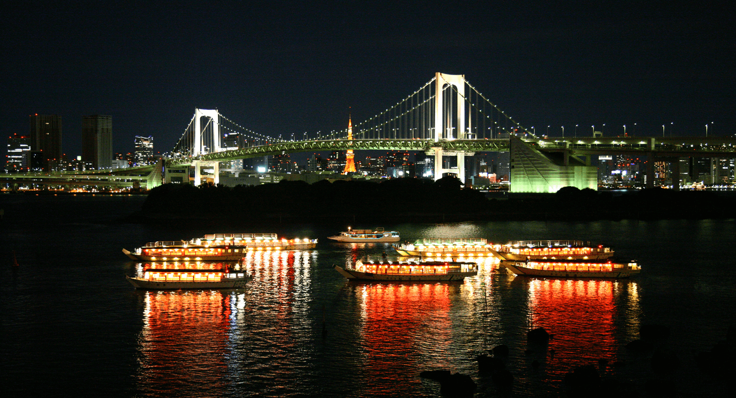 The pleasure boats gathered at the base of Rainbow Bridge.